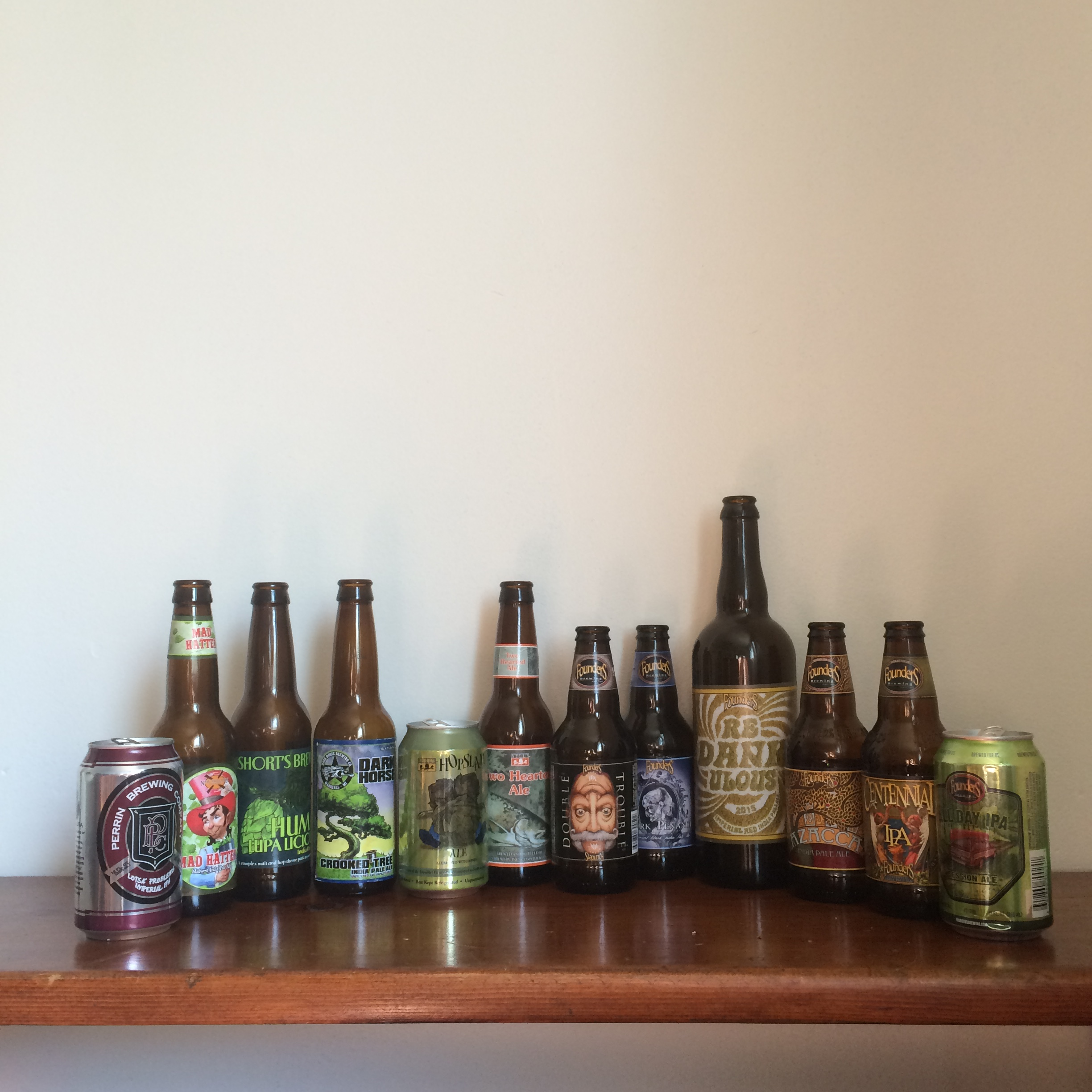 A photo of 12 different Michigan IPAs for a craft beer tasting event. Includes beer from Perrin Brewing, New Holland Brewing, Short's Brewing, Dark Horse Brewing, Bell's Brewery, and Founder's Brewing.