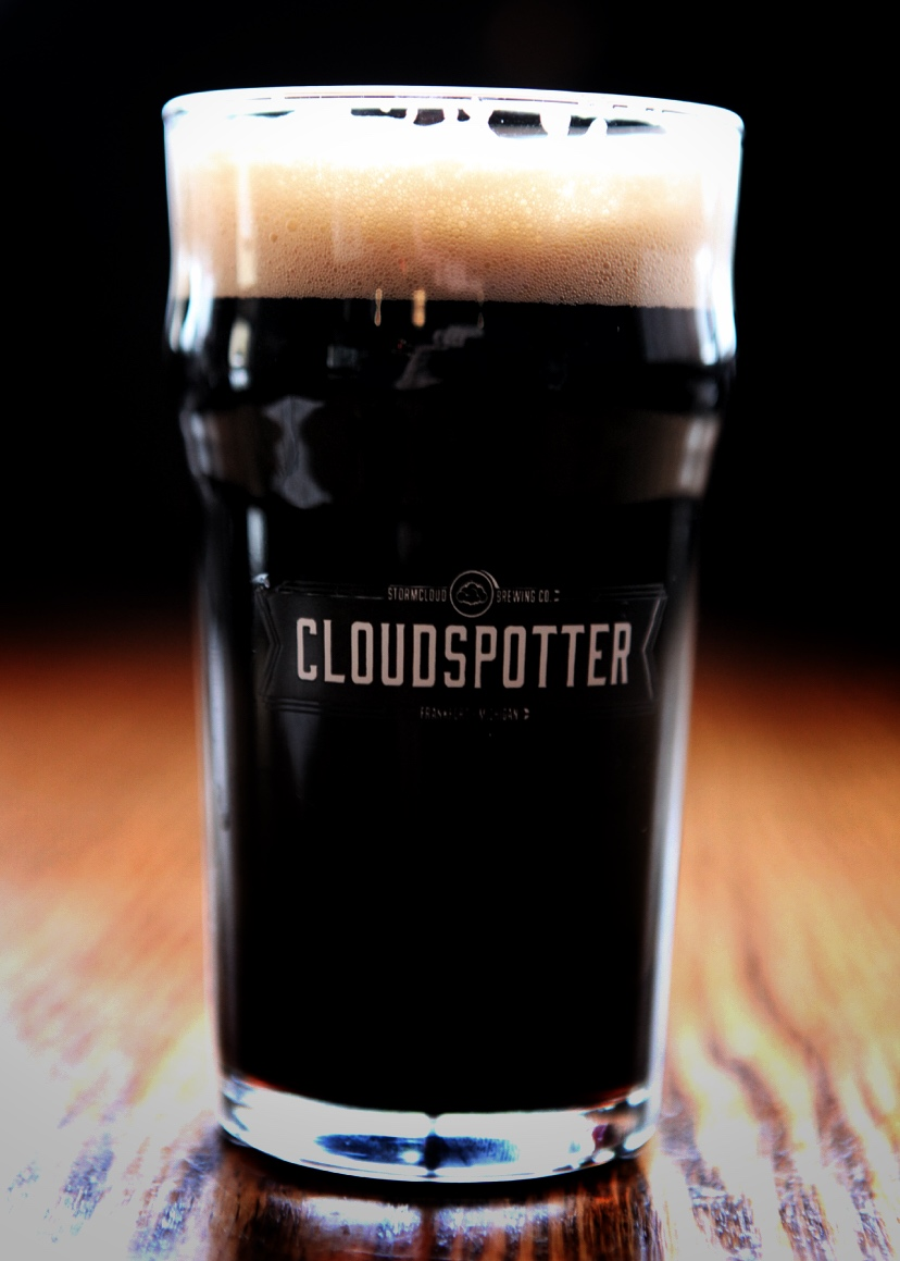 Photo of a pint class that contains the craft beer Saison du Stormcloud, an example of a dark saison.
