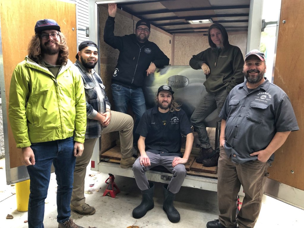 Stormcloud brewing Company Brewers posing with the Speciation Artisan Ales crew and coolship.